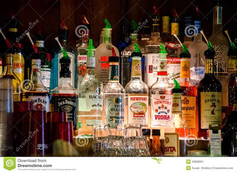 alcoholic drinks at a bar bottles of on display at a bar editorial photo