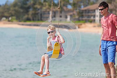 swinging on vacation family on vacation stock photo image 61000805