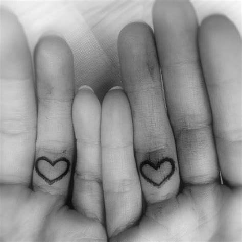 heart tattoo on wedding finger 43 awesome hearts tattoos on finger