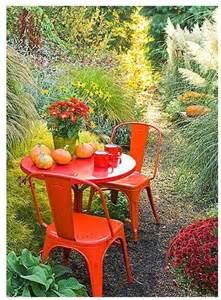orange painted patio furniture gnome at home