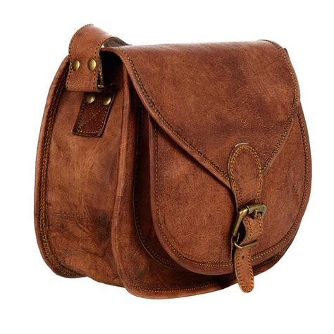 saddle bag curved brown leather saddle bag by paper high notonthehighstreet