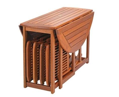 Folding Table With Chair Storage Deluxe Oval Storage Table And Chairs Made From Hardwood Chairs Stored Underneath Tiny House