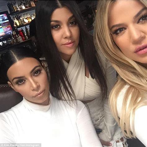 sister selfie kourtney khloe and kim kardashian wear white outfits
