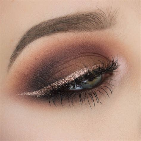 Eyeshadow Smokey brown smokey eyeshadow with gold eyeliner sultry