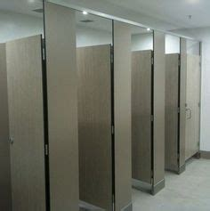 bathroom partitions michigan toilet partitions with special 100mm leg in a timber grain compact laminate sw project