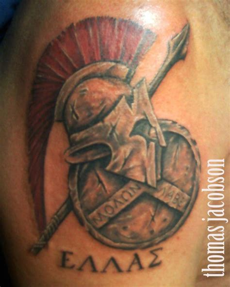 roman shield and helmet tattoo by thomas jacobson