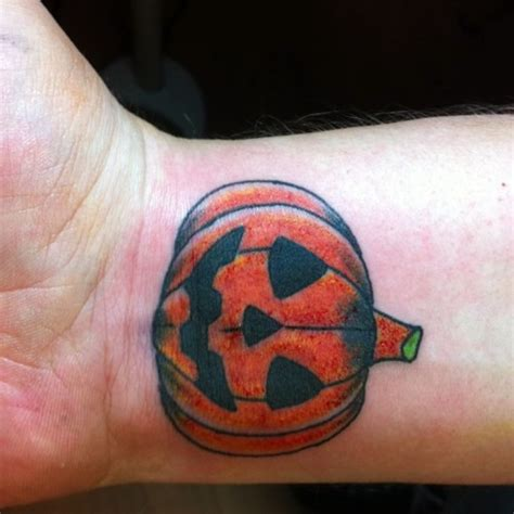 pumpkin tattoos pumpkin on right wrist