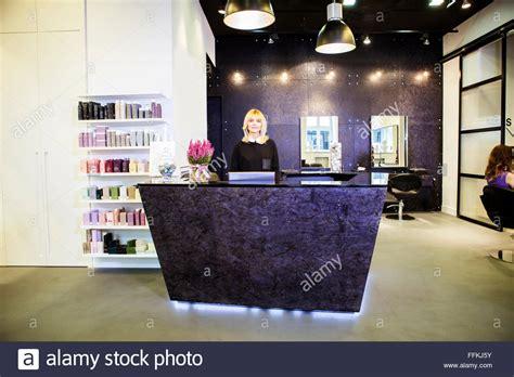 receptionist in hair salon stock photo royalty