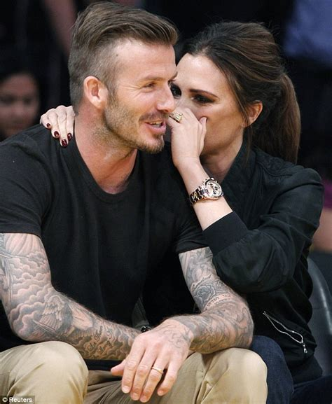 victoria beckham giggles in embarrassment as she and david