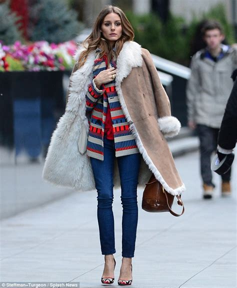 As she models trendy coats during an outdoor photo shoot in manhattan