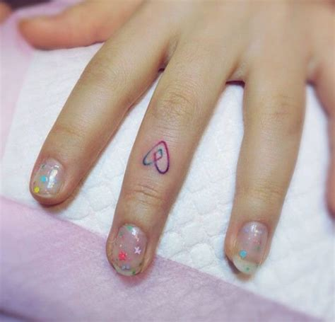 heartbeat tattoo on finger rainbow heart tattoo on middle finger