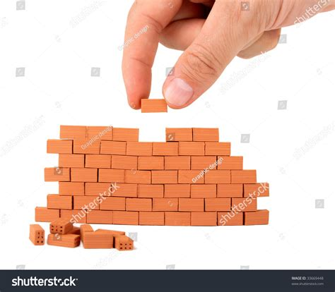 building a small brick wall on white background stock