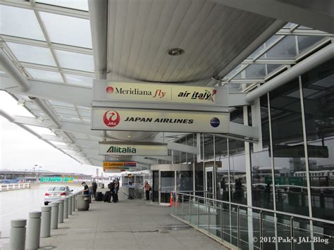 jal flyer sling oneworld premium services japan airlines new york jfk check in
