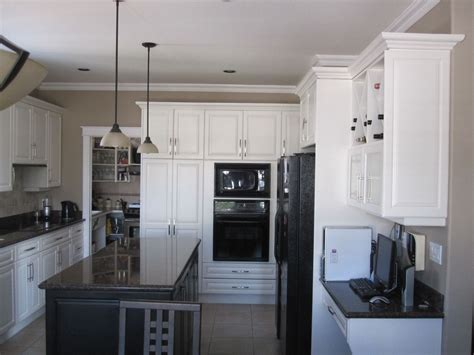 White Paneling In Kitchen by Custom White Raised Panel Kitchen By S Custom