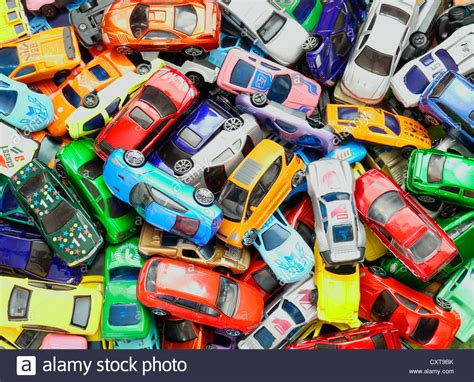 Mainan Mobil Stunt Vechile lots of cars in a pile stock photo royalty free image