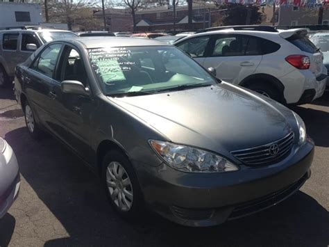grey year   toyota model camry miles