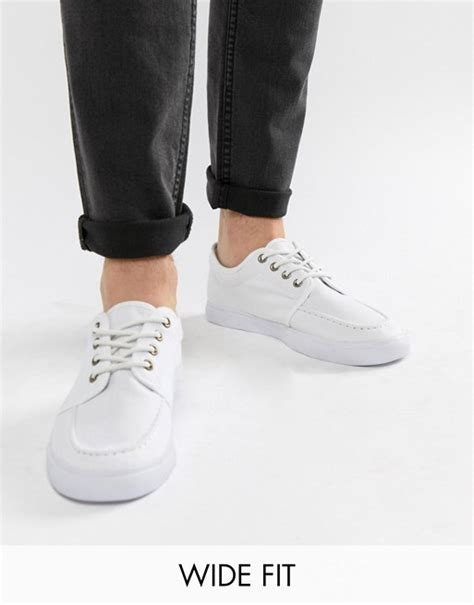 Asos Lace Up Plimsolls In White by Asos Asos Wide Fit Lace Up Plimsolls In White Canvas