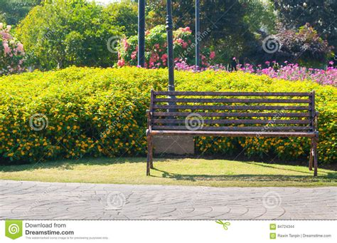 bench in the garden flower garden vintage bench stock photos images pictures