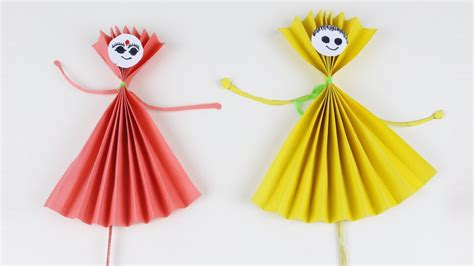 Make Paper Dolls - origami and yellow paper dolls how to make paper