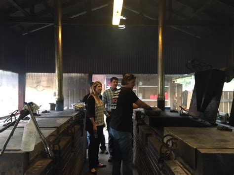 pit room hacking wood cooked bbq in houston tmbbq