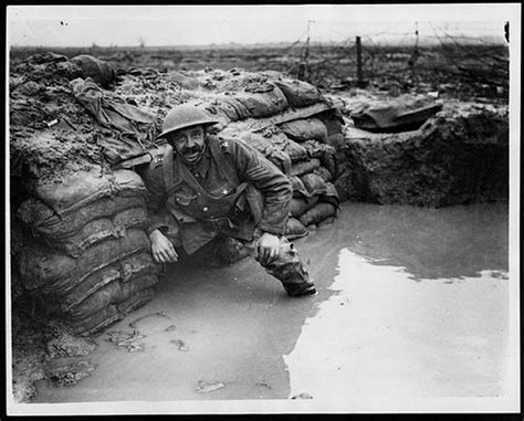 Mud How I Dug Myself Out Of The Daily Grind flooded dug out in front line trench soldier in a