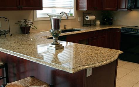 Light Cherry Kitchen Cabinets by New Venetian Gold Granite