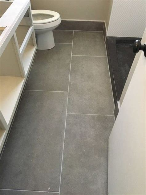 Large floor tiles in a small bathroom really makes an