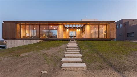 House Of Ls by Gaston Sironi Elevates Ls House A Corten Clad Dwelling In