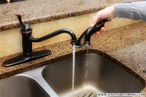 how do i replace a kitchen faucet replacing my kitchen faucet its overflowing