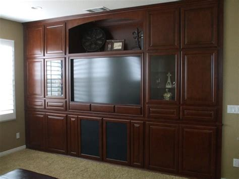 home entertainment cabinetry traditional living room entertainment centers traditional living room orange