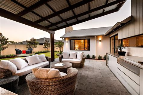 Outdoor Patio Design Pictures A Modern Wicker Set With An Outdoor Kitchen Set A Slanted Canopy For A Delightful Backyard