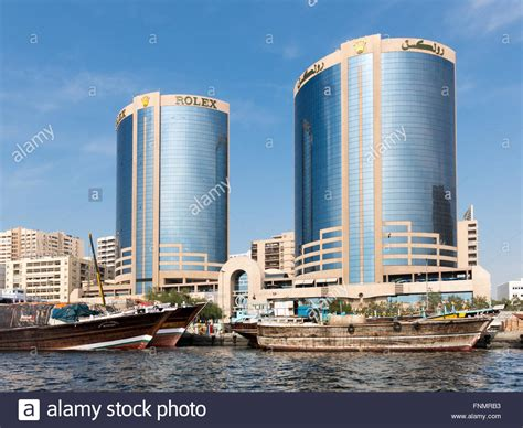 dubai boat tower dhow boats and deira twin towers or rolex towers in rigga