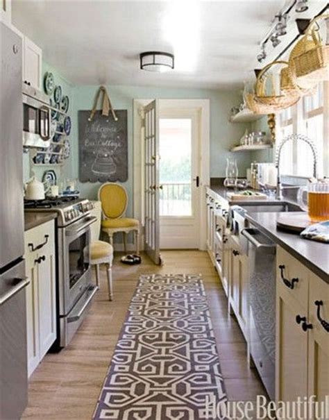 galley kitchen with cabinets and blue wall kitchen kitchen cabinets