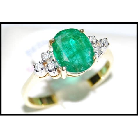 18k yellow gold solitaire eternity emerald ring