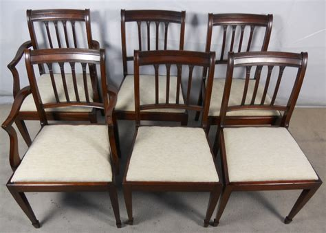 six mahogany dining chairs in antique style