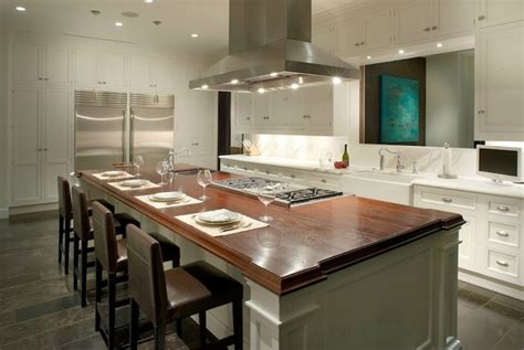 kitchen island with cooktop and seating center island with stove top and seating gutted kitchen butcher blocks white