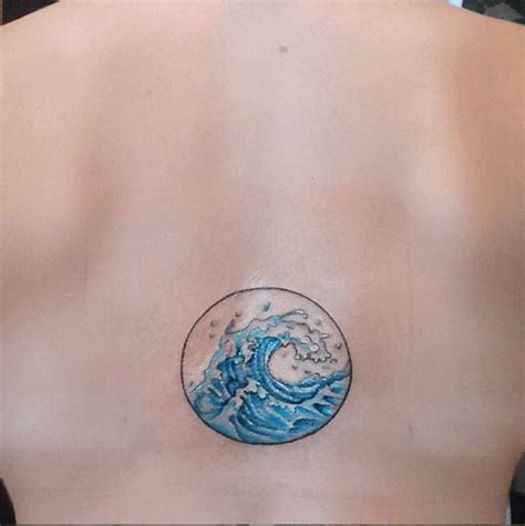 watercolor tattoo wave blue ink wave in circle frame on back