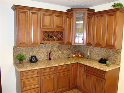 Brown Wooden Curving Kitchen Cabinet With Cream Marble Counter Top Combined With Floating