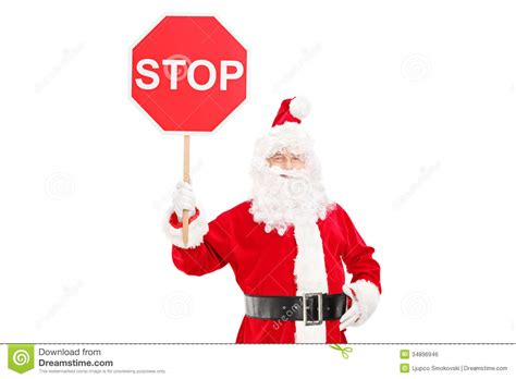 smiling santa claus holding a stop sign royalty free stock