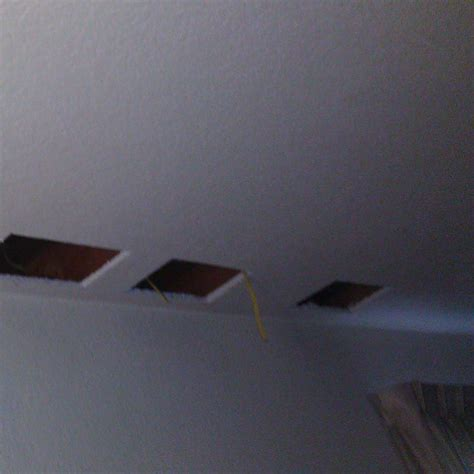 Cutting In A Ceiling by Installing Retrofit Recessed Lighting Without Attic Access