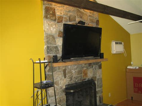 canaan ct tv install  natural stone  fireplace