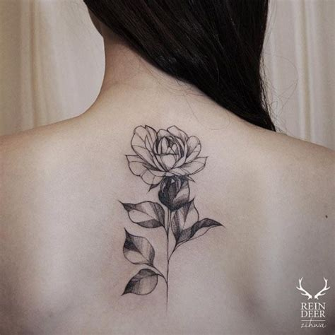 rose tattoo on spine 40 blackwork tattoos you ll instantly