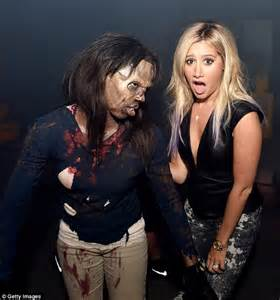 Ashley Tisdale at The Walking Dead premiere on arm of