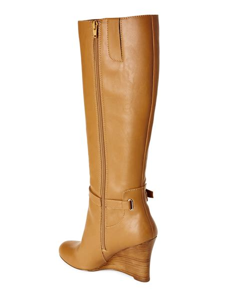 nine west ovata wedge boots in brown lyst