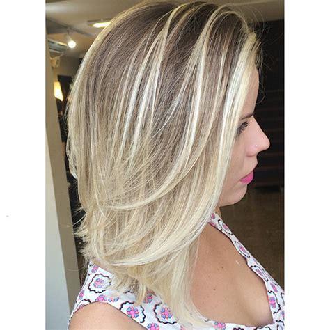 medium length dark hair with ash blonde platium high lights straight mid length ash blonde hair with layers medium