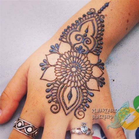 hire remarkable blackbird henna tattoo artist in
