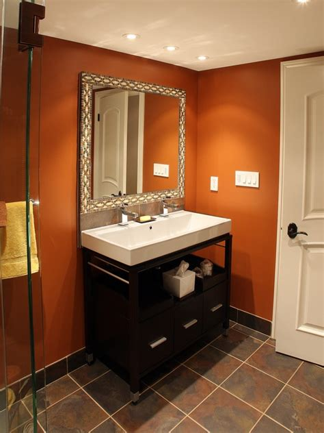 half bath idea warm terracotta walls dark tile floor