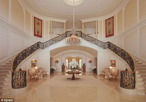 the mansion project the mansion s grand stair hall candy spelling s big move from her 85 million mansion is