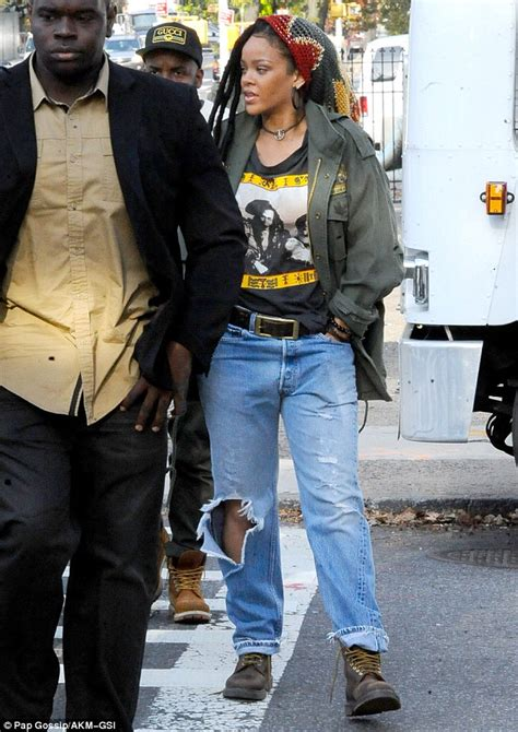 Set Premi Ny Denim rihanna in ripped and knit hat as she returns to nyc