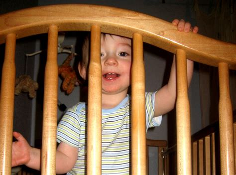 Toddler Climbing Out Of Crib by Toddler Climbing Out Of The Crib